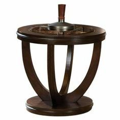 """Round end table in cherry with a beveled glass top and curved legs.    Product: End tableConstruction Material: Veneers, wood and glassColor: CherryFeatures: Removable beveled glass top  Dimensions: 24"""" H x 26"""" Diameter"""