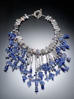 In this necklace I have combined oxidized silver with grey pearls, blue chalcedony and lapis. The pearls and beads hang from a 18 1/2 inch sterling
