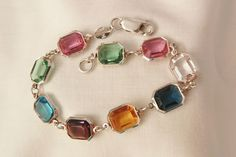 September sale many items reduced from 20 to 60% off Visit my Ruby Plaza Shop Link on home page     Gorgeous Italy Sterling Jour square bevel cut pastel gem color crystal from vintageshari on Ruby Lane