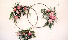Floral wedding ceremony decor idea - hanging, floral wreaths as ceremony backdrop {Hyde Park Photography}