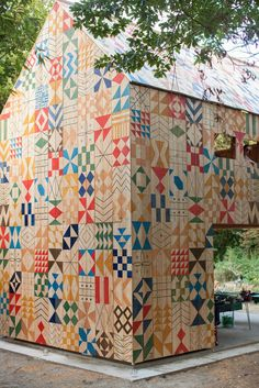 Ecology of Colour is a collaboration between Nous Vous and Studio Weave that sees William Edmonds' precise geometric designs hand-painted onto a beautiful cedar structure, creating an approachable and inviting environment to house dyeing and wildlife workshops for the local community