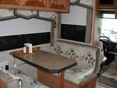 wow, this is kinda the setup/layout we already have configured inside....it shouldn't be too hard to redo if we went with this!        Remodeling Your RV's interior: RV window shades, finally something better! A solar shade and blackout shade combined on two rollers.
