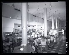 Interior view of Pope's Cafeteria. The image shows the dining area, with serving counters visible in the background. Photograph taken by Henry T. (Mac) Mizuki, 1953. Mac Mizuki Photography Studio Collection, Missouri History Museum.
