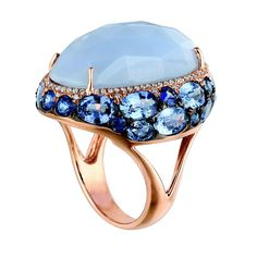 22 ct. Chalcedony center accented by diamonds and 7.25 ct. Ceylon blue sapphires