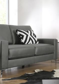 Patterned cushion on retro style sofa