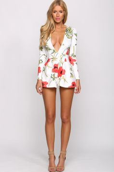 """Our Spring look: Long-sleeved polyester red/green floral print plunging V neckline, invisible back zip. Red/green floral print, & Side pockets""""Brie""""Playsuit. Available at hellomolly.com"""
