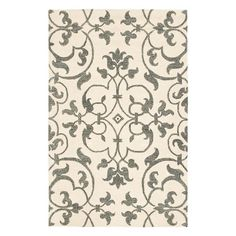 Hand-tufted New Zealand wool rug with a scrolling vine motif.   Product: RugConstruction Material: New Zealand wool