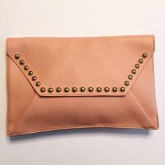 Rebecca Minkoff Pink Leather Envelope Clutch Excellent used condition. Only carried once. Great for the upcoming Spring and Summer seasons. Has gold hardware. No dust bag. 100% Authentic. Shows very little signs of wear. I would rate this bag a 9.5 out of 10. I don't trade so please do not ask. I only sell on Posh so don't ask if I sell on other sites or take paypal.  Do not ask what my lowest is or comment with an offer price. Please use the offer button to make a reasonable offer. Rebecca…