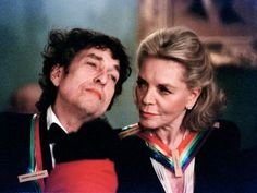 Bob Dylan and Lauren Bacall chat during a Kennedy Center Honors party at the State Department in December 1997.