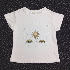 "jgaltusa: "" #jgaltusa "" My illustration is available on a t-shirt by Brandy Melville. http://www.brandymelvilleusa.com/graphic-tops/golden-sun-eyes-top.html $20 S/M"