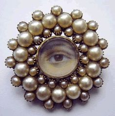 Georgian eye brooch in a gold and pearl frame, circa 1800,