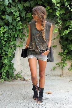 Summer outfit: cutoff tee, short shorts, fringed gladiator sandals; braid and shades.