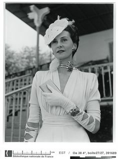 1939 - Perhaps a little over-accessorized, distracting from the pretty draping of the bodice.