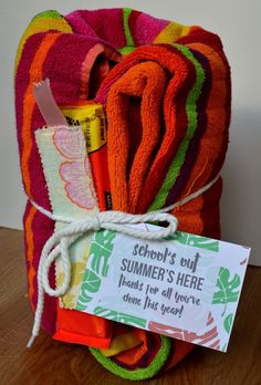 Beach towel, Candy, Bookmark end of year teacher gift. gift baskets end of year End of the Year Teacher Gift Ideas Beach Gifts, Summer Gifts, Teacher End Of Year, Teacher Gift Baskets, Teacher Treats, Teacher Notes, Preschool Gifts, Preschool Ideas, Teacher Christmas Gifts