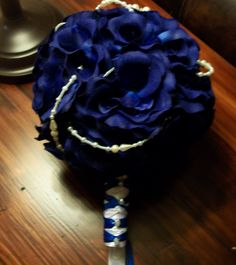 """Total Bouquet is 7"""" blue rose bouquet with pearl brooch, 2 strands pearls, double stranded princes wrapped handle with pearl gem accents. $32.00 USD www.etsy.commyglorifidlife"""
