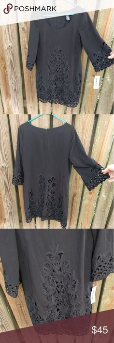 Quotation Brand Laser Cut Embroidered Black Dress Brand originally sold at Bloomingdale's. Still had tag. Features full lining, hidden back zipper, beautiful flower cutouts and embroidery at bottom of dress and sleeves, slightly bell sleeved 3/4 sleeve design. Bloomingdale's Dresses Long Sleeve