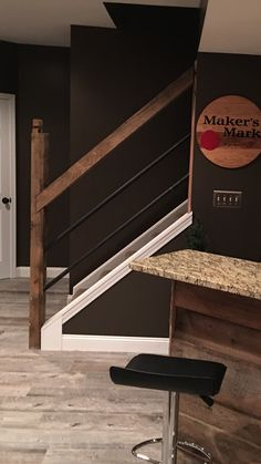"""Mortised this beam together for the heavy duty hand railing. Banisters are 1.5"""" iron piping which is pegged on the opposite side to reflect the craft of what these beams were actually used for. Makes you wonder what you are walking into as you approach the basement. Sets the tone for the rest."""