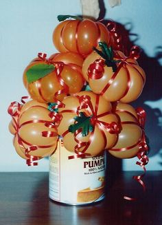 """Balloon pumpkins - see """"how to"""" on Betallic's website www.betallic.com      Here's the link to bdecor #104: http://www.betallic.com/designfiles/104_pumpkin.pdf"""
