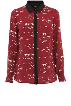 This long sleeved shirt has an all over running hound print with a contrasting colourblock collar. #modernheritage