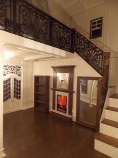 Check out the interior of this custom playhouse.  Look at the scroll work on the staircase!    Made by Lilliput Play Homes