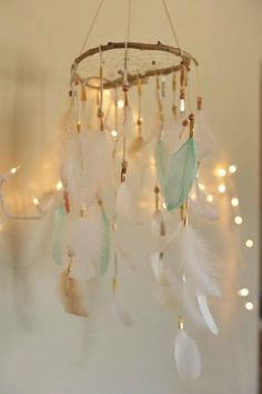Fun with Feathers :: How about a beautiful, dreamcatching mobile to dress up a bedroom or perhaps your laundry room? Or, hang above your baby's crib!