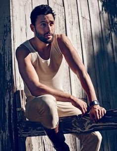 American model Noah Mills wears a pair of leather riding boots with a casual ensemble for The Sunday Telegraph.