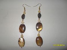 Brown and cream beaded dangle earrings.