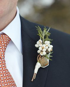Clustered ivory tallow-berry branches with tiny acorns, rosemary foliage, and gray silk