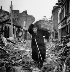 People with some supplies in a bombed Cologne, 1945.