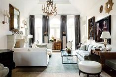 love this living room designed by Suzanne Kasler. It is white without being clinical, and so warm because of her use of linen and leather, ...