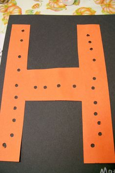 "Punching holes in the letter ""H"""