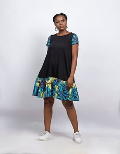 With its shift shape and high neck, the Ekan is a dress that suits a variety of heights and shapes. Frill detailing to the hem sets it apart from other designs. Latest Ankara Dresses, Ankara Dress Styles, Latest Ankara Styles, Ankara Blouse, Ankara Tops, African Print Fashion, African Fashion Dresses, Fashion Prints, Ankara Fashion