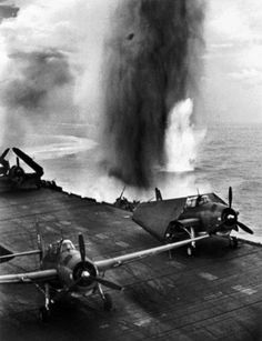 The USS Bunker Hill aircraft carrier being attacked by Japanese planes during the US air raid of the island of Rabaul - 11 November 1943. Photo by W. Eugene Smith