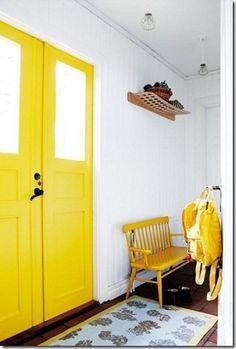 Yellow door and bench #mudroom #yellow