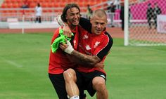 """Liverpool FC (Twitter): """"Lazar Markovic and Martin Skrtel share a laugh during open training in Bangkok #LFC"""""""