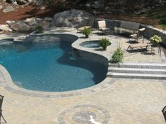 All the bells and whistles for this backyard oasis, #pooldeck. Love the flush hot tub and fountain.