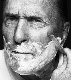 Duvall. Straight razor shave.  Dragging a blade that can kill you across your neck every morning is pretty manly.