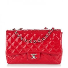 This is an authentic CHANEL Patent Jumbo Single Flap in Red. This stunning shoulder bag is crafted of fine diamond quilted patent leather.