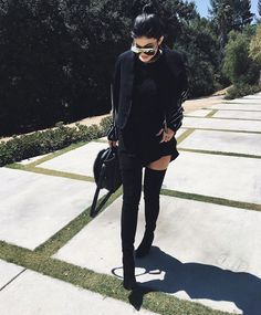 this is my mood sometimes. all back everything. love the over the knee boots. i have a pair that i wear all the time in winter. like the idea of wearing them with shorts.