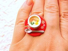 "This is soooo cute! This dish is called ""chawanmushi"". It is a savory egg custard that is very popular in Japan.      It is on a silver tone adjustable band that will fit most ring sizes. It measures about 2.5 cm wide (1 inch).    SouZouCreations' products are made with attention to detail, creativity and long lasting dependability."