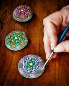 painted rocks as paper weights. Super cute !