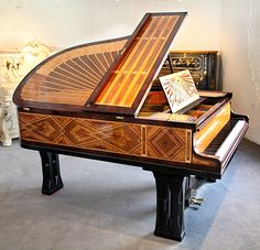 Schiedmayer  grand piano for sale  with a  rosewood case intricately inlaid with art-deco geometric designs Designed by Peter Behrens