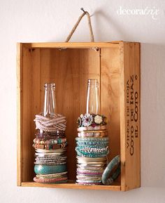 Glass bottles repurposed as bracelet storage/display