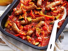 Mediterranean baked sausages recipe - By Woman's Day, Hot, hearty and packed full of tasty chipolata sausages, this beautiful one-pot meat dish is baked in a thick vegetable and tomato sauce to produce a warming and satisfying family meal. Easy Home Recipes, Easy Chicken Recipes, Pork Recipes, Cooking Recipes, Dinner Recipes, Pork And Beef Recipe, Budget Family Meals, Cooked Apples, Recipes