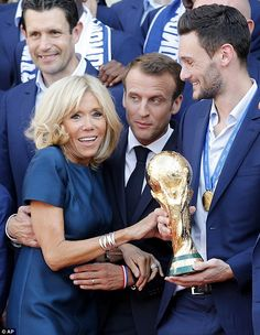 Patriotic: Macron donned a navy suit and tie as well as a red, white, and blue rubber bracelet that matches France's tricolor flag French First Lady, Beaux Couples, Brigitte Macron, Donald And Melania, Ladylike Style, Ladies Gents, Emmanuel Macron, Hot Hair Styles, First Lady Melania Trump