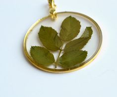 Rose leaves in resin pendant by twocatsboutique on Etsy, $25.00