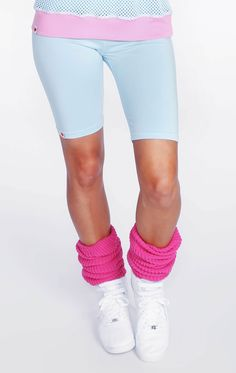 These legwarmers are knit from a chunky, cotton blend. Ribbed detailing. Elastic looped in top leg opening and a gold, WIldfox emblem fastened along the bottom.  60% Cotton, 40% Bulky Acrylic