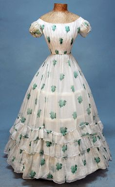 YOUNG LADY'S SUMMER PARTY DRESS, White cotton voile with horizontal pinstripe weave printed with shaded green oak leaves, having drawstring boatneck, short puffed sleeve~~~ so Scarlett O'Hara at Tara Vestidos Vintage, Vintage Gowns, Mode Vintage, Vintage Outfits, Vintage Hats, Civil War Fashion, 1800s Fashion, Victorian Fashion, Vintage Fashion