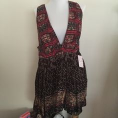 Free people Red tunic NWT dress Free people Red tunic NWT. Gorgeous piece. Tunic with a tail, longer in the back skirt. Red and black combo. Free People Dresses Mini