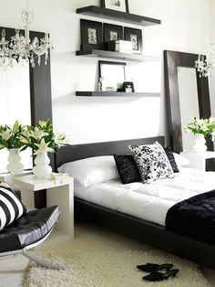 Two floor-length mirrors complement the black wood-framed bed and highlight two glass chandeliers: http://www.bhg.com/rooms/bedroom/themes/contemporary-bedrooms/?socsrc=bhgpin030114blackandwhite